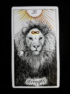 The Strength Tarot Card.
